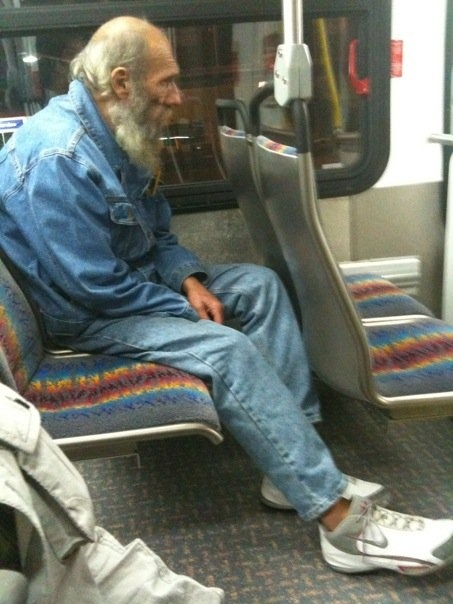 Someone gave this homeless guy their trainers on the bus.