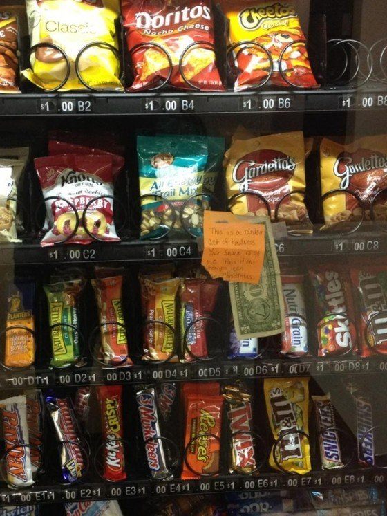 This post it note and dollar bill was placed on a vending machine so the next person can get their snack for free.