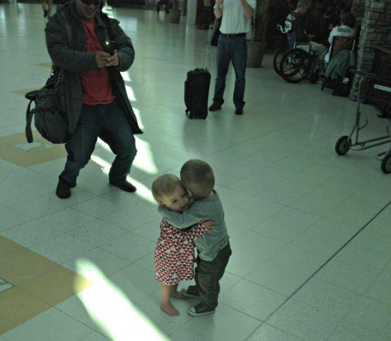 2 toddlers greet each other with a hug even though they have never met before.