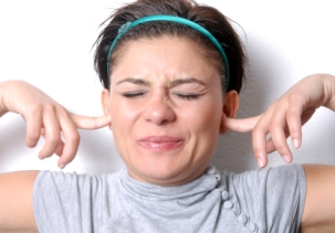 woman-with-fingers-in-ears